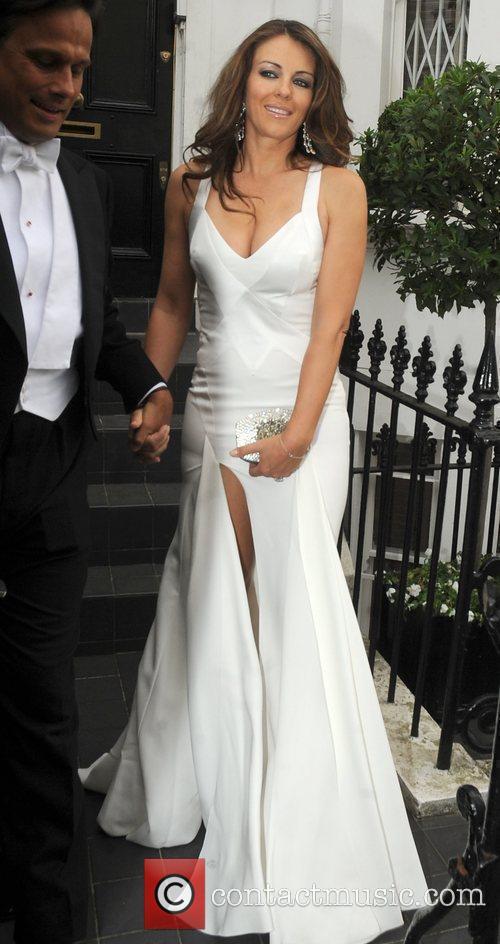 Elizabeth Hurley leaves home for Elton John's Tiara...