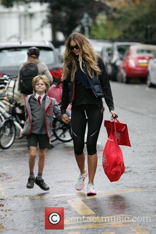 Elle Macpherson walking her son Aurelius to school...