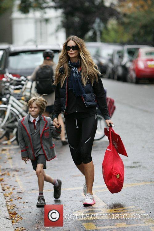 Walking her son Aurelius to school