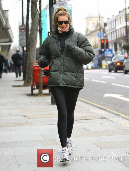 Elle Macpherson jogs home after dropping her son...