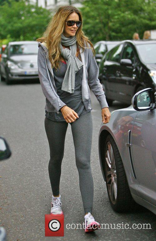 Elle Macpherson returns to her car after dropping...