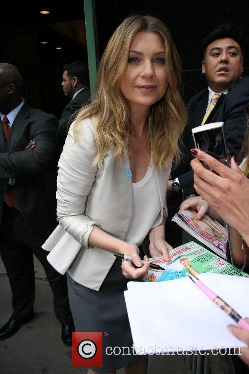 Signs autographs for fans while leaving the GMA...