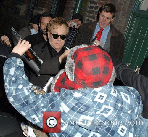 Elton John leaving his exclusive gig with Absolute...