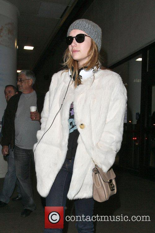 Emma Roberts arriving at LAX on a flight...