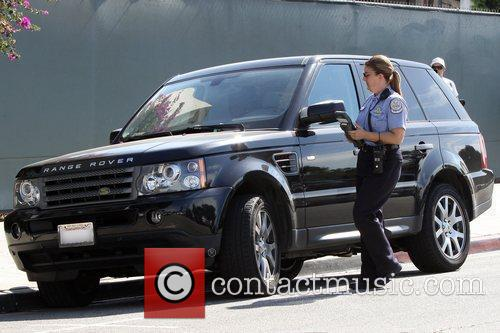 A Beverly Hills Parking Enforcment Officer issues Emma...