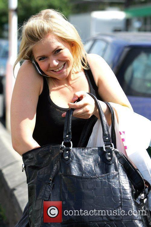 Suzanne Shaw talks on her mobile phone as...