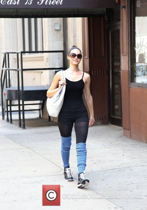 Actress Emmy Rossum makes her way home after...