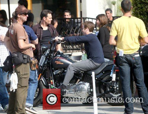Kevin Dillon and Kevin Connolly sitting on a...