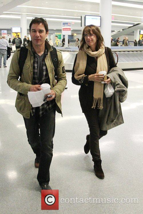 eric mccormack janet holden arriving at jfk airport. 5443404