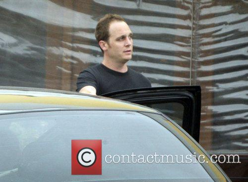 Actor Ethan Embry  checking out his car...