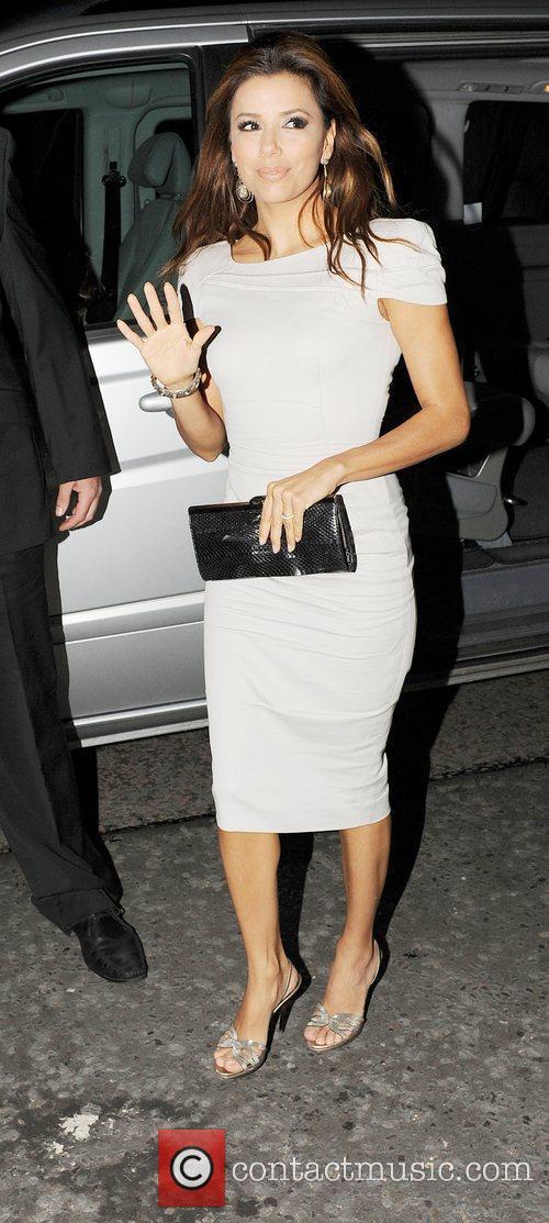 Eva Longoria and Victoria Bechham, both in stylish...
