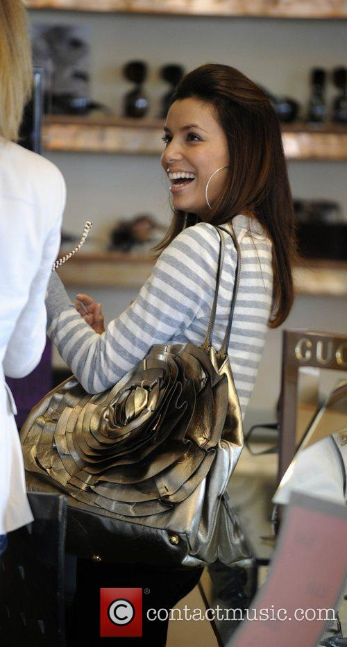 Eva Longoria Parker tries on sunglasses while shopping...