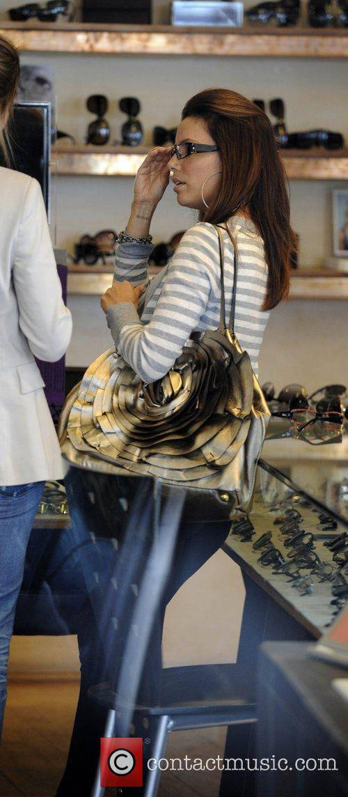 Eva Longoria Parker tries on sunglasses while shopping...