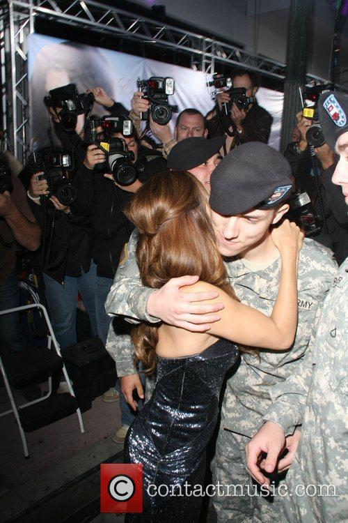 Eva Longoria Parker hugs a member of the...