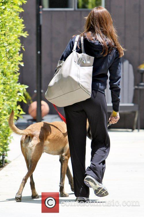Eva Mendes and her dog  leaving her...