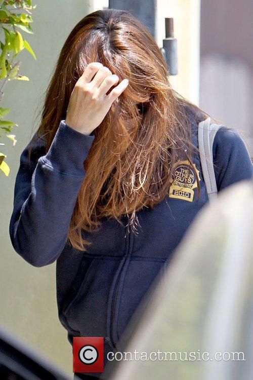 Eva Mendes covers her face with her hair...