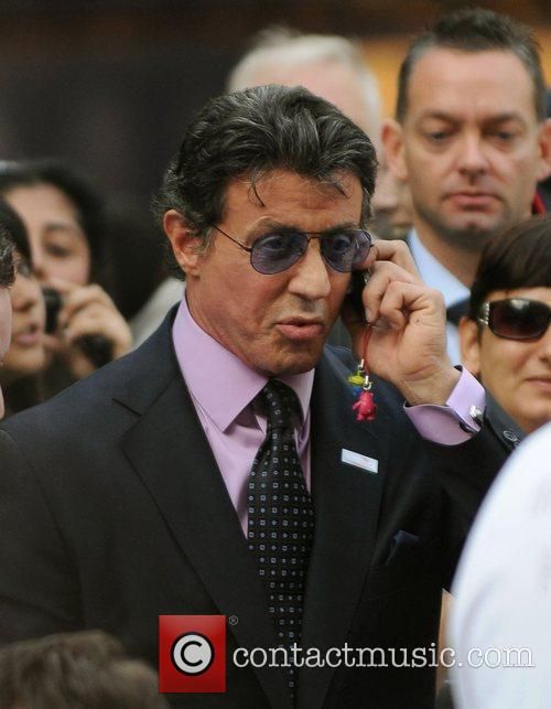 Slyvester Stallone talks on his mobile phone 'The...