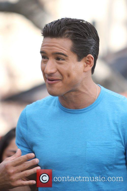 Mario Lopez filming a segment for 'Extra' at...