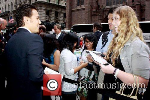 Olympic gold medalist Apolo Ohno greets fans as...