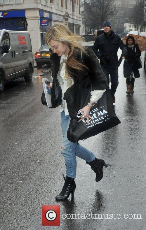 Running to her car to avoid the rain...