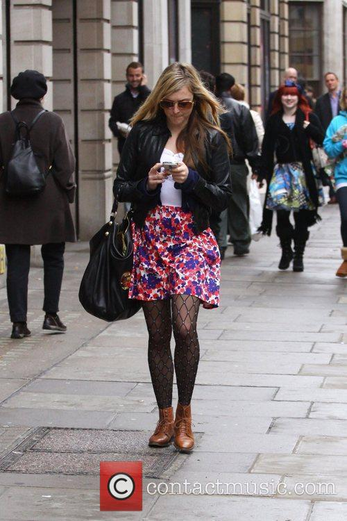 Fearne Cotton texts on her phone as she...