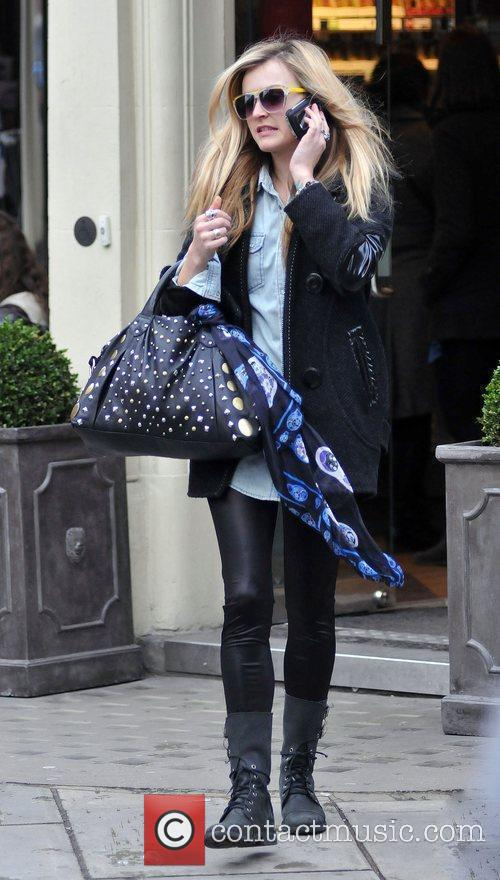 Talks on her mobile phone after leaving the...