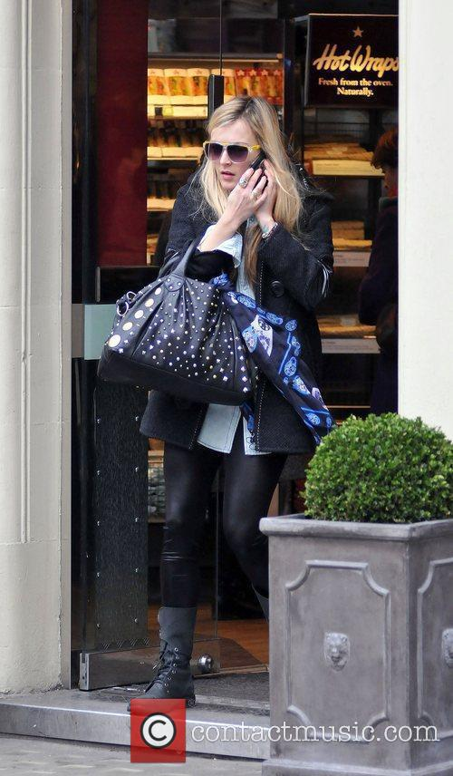 Fearne Cotton talks on her mobile phone whilst...
