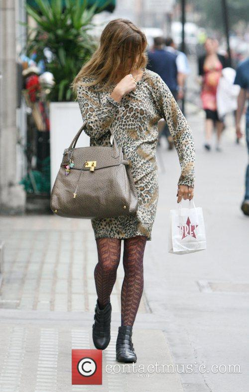 Fearne Cotton struggles with her leopard print dress...
