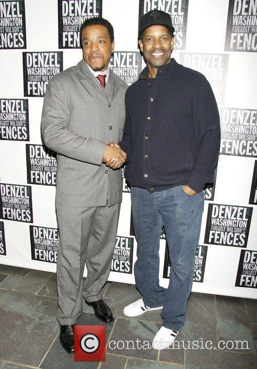 Actor Denzel Washington pose for photos at the...