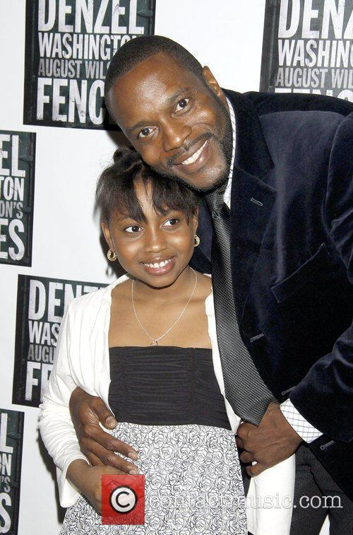 SaCha Stewart-Coleman and her dad pose for photos...