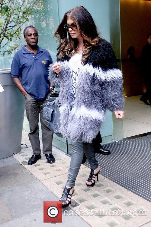 Leaving St. Martin's Lane Hotel before her concert...