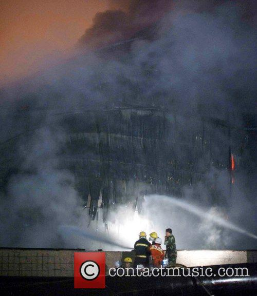 Firefighters try to put out the remaining fire...