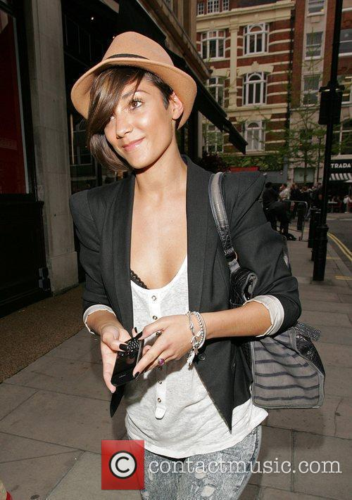 Sporting a trilby hat as she strolls through...