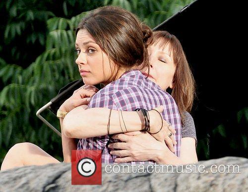 Mila Kunis filming on the set of her...