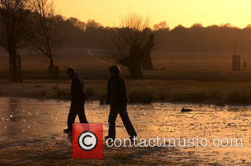 Children Playing on Frozen Lake in a London...