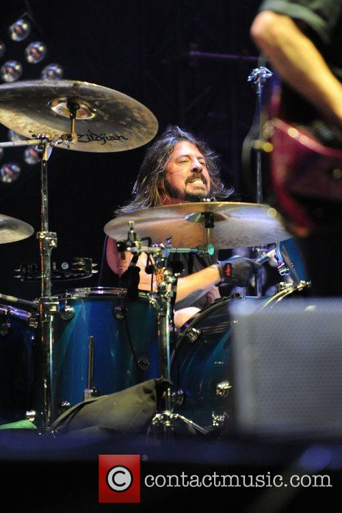 Dave Grohl of Them Crooked Vultures performing at...
