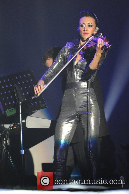 Violinist Anne Phoebe performing with Bryan Ferry and...