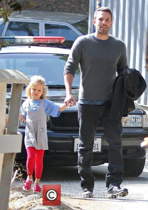 Ben Affleck walking with his daughter Violet to...