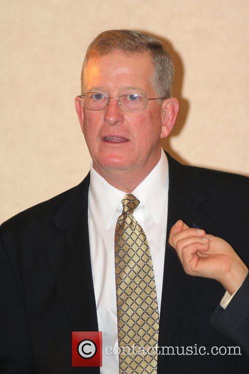 WVU Coach Bill Stewart speaks during the final...
