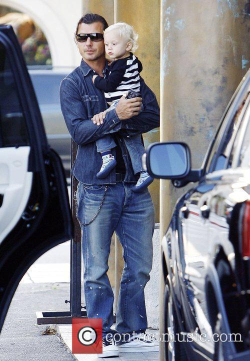 Gavin Rossdale carries his son Zuma as they...