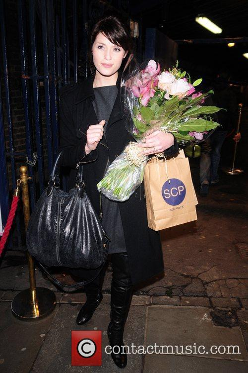 Leaving the Garrick Theatre after performing in the...