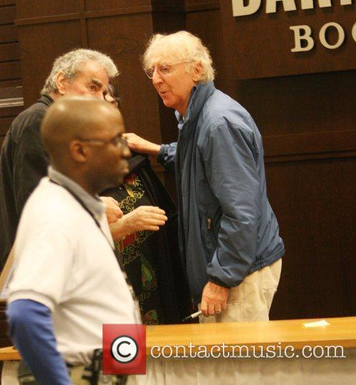 Gene Wilder was spotted signing his copies of...