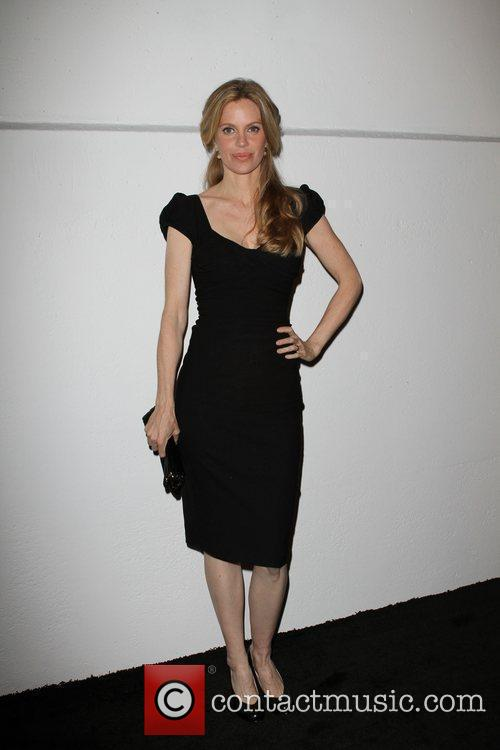 Kristen Bauer, Genesis