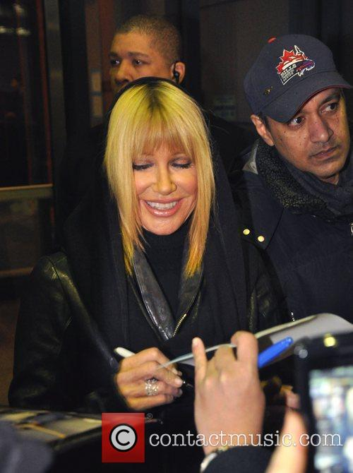 Signing autographs outside CBC's 'George Stroumboulopoulos Tonight' show
