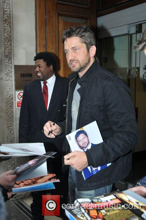 Signs autographs outside the Radio One studios