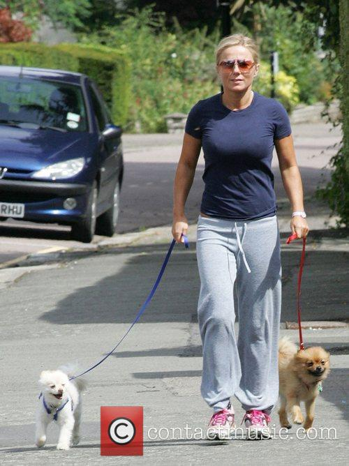 Walking her dogs in Hampstead