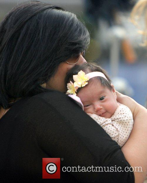 With her newborn daughter Gia Lopez in a...