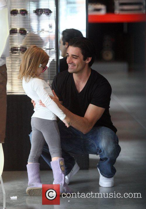 Shops with his daughter Julianna at the Armani...