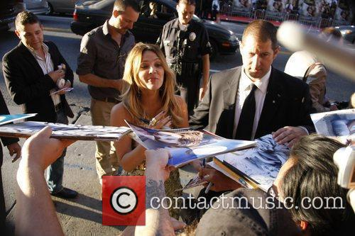 Signing autographs outside the Los Angeles premiere of...