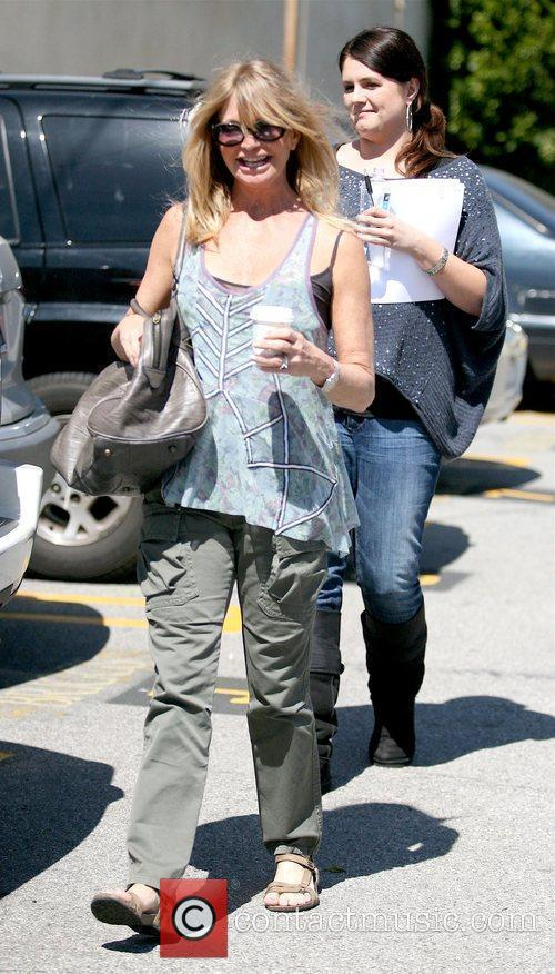 Leaving a yoga class in Santa Monica carrying...